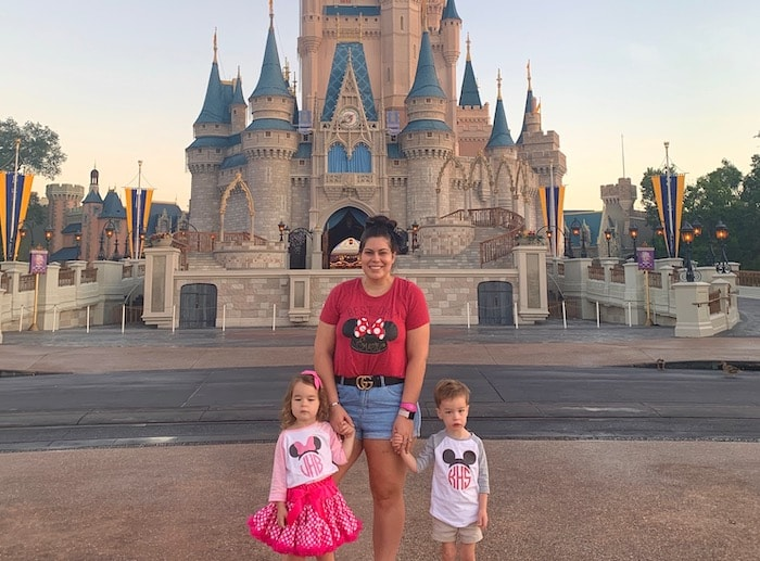 mom with 3 year old twins in front of cinderella's castle in the magic kingdom disney world alone