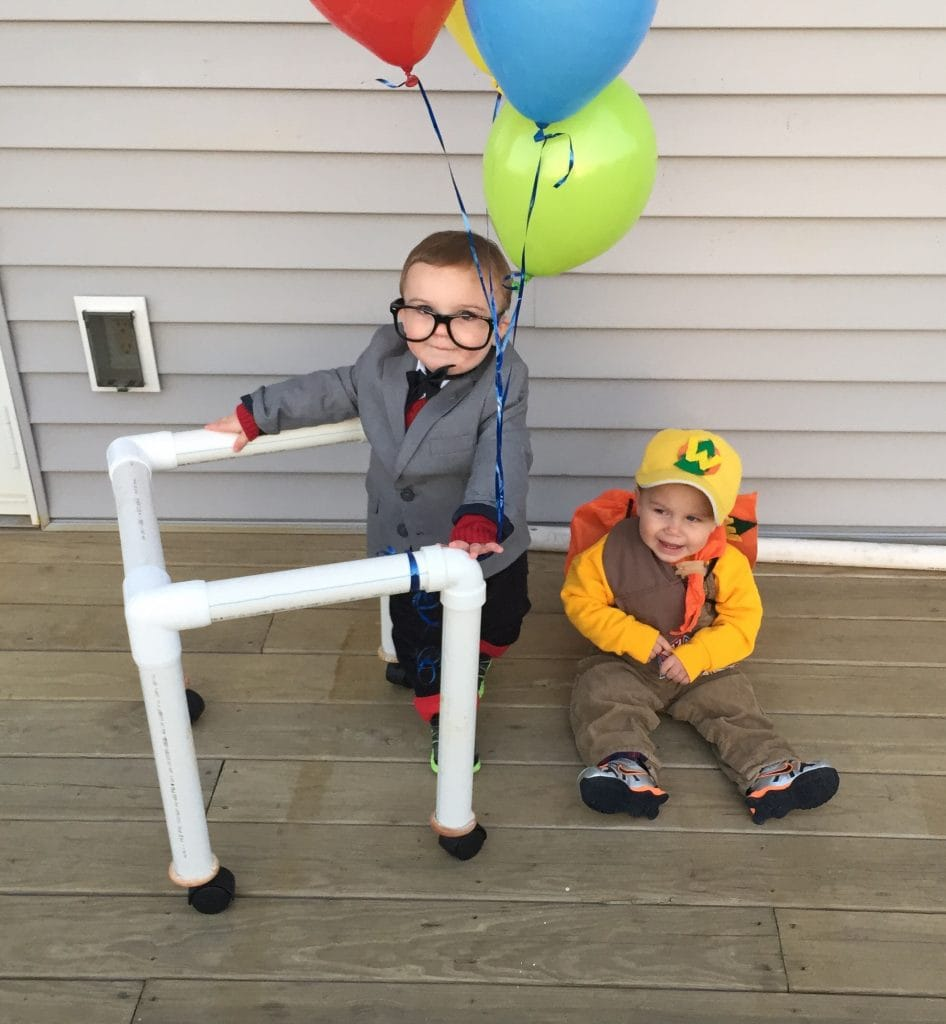 toddler twin boys dressed like characters from the Disney/Pixar movie UP