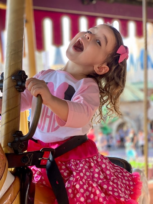 girl on carousel disney world alone