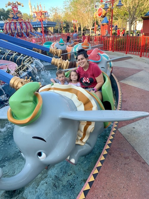 mom on dumbo ride with kids at disney world alone