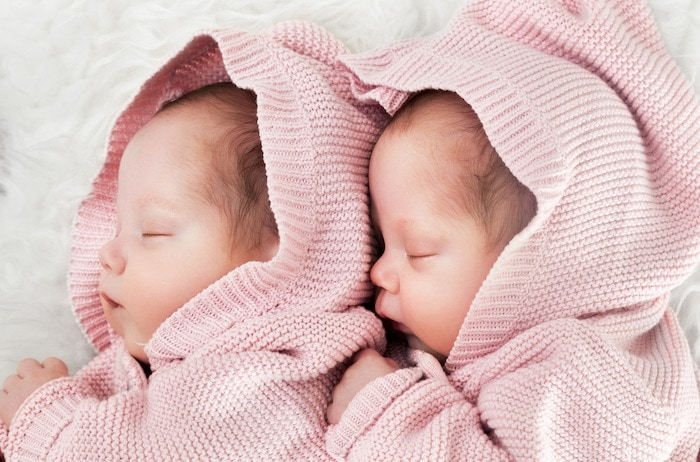 infant twins sleeping financial crisis