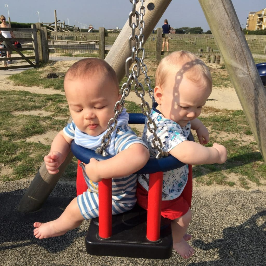 twin boys in a swing twin resources