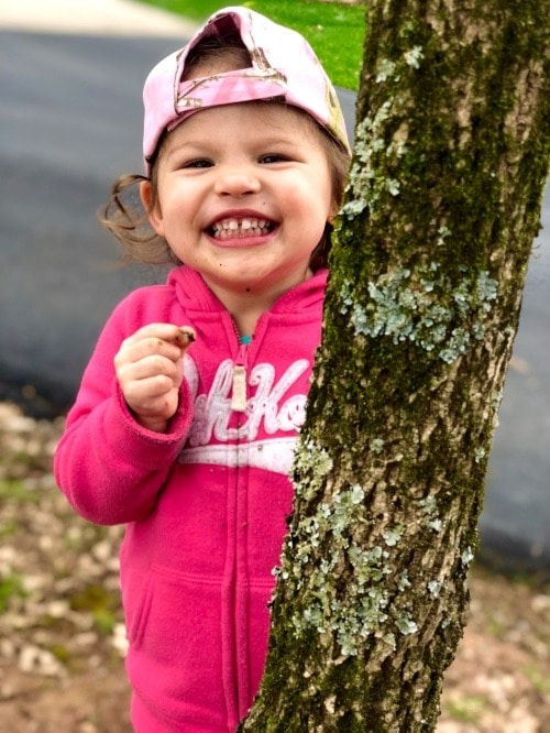 little girl with tree welcome spring