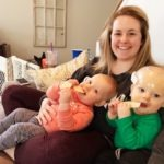 mom holding twins stay at home mom