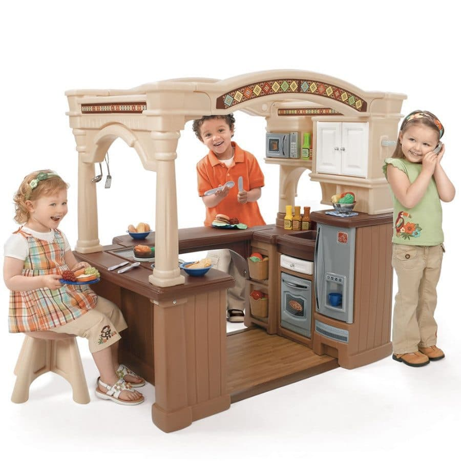 kids playing in a toy kitchen creative play