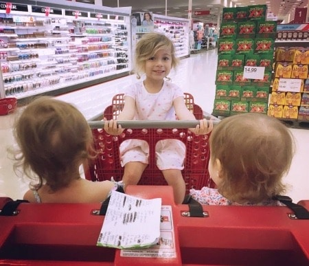 twins and older child in grocery cart Twins Made Me