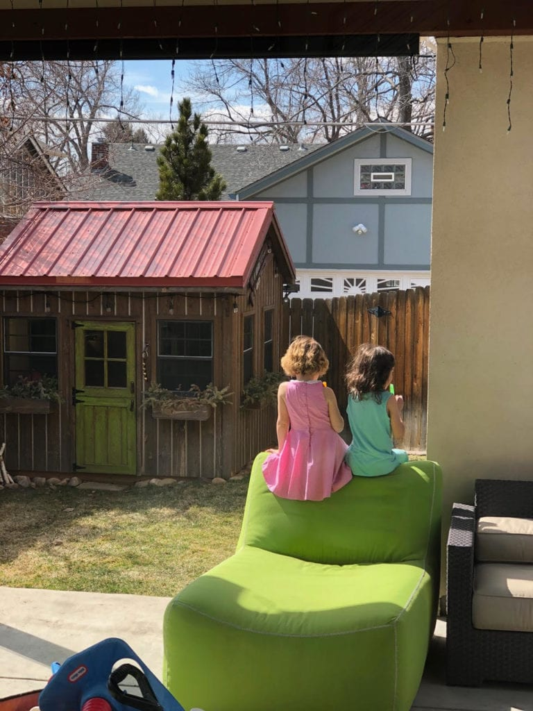not traveling two girls sitting in the backyard