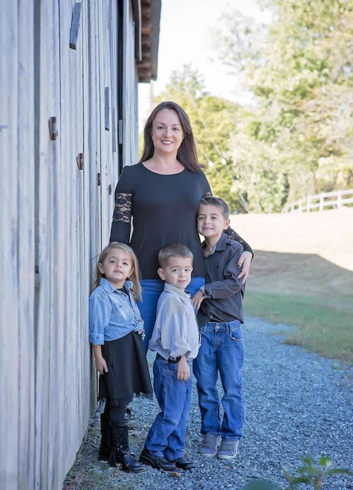 mom and children standing outside house uterine prolapse surgery