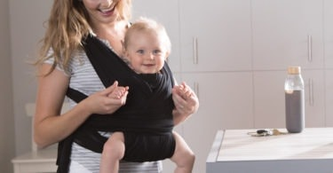 mom carrying baby truth about babywearing