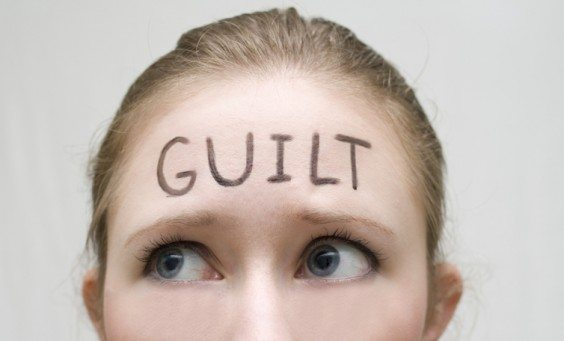 woman with the word guilt on her forehead mom guilt