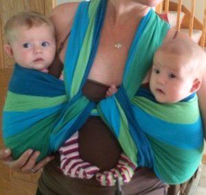 woman wearing twins in a wrap
