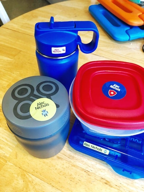 lunch food containers on a kitchen table get organized