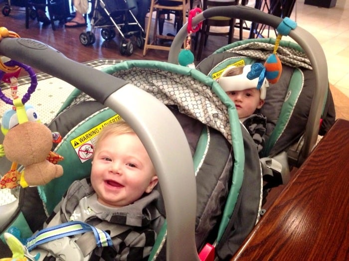 twin boys in car seats and snap n go double stroller out the door with twins