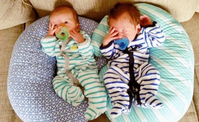 newborn twins on pillows exclusively pumping for twins