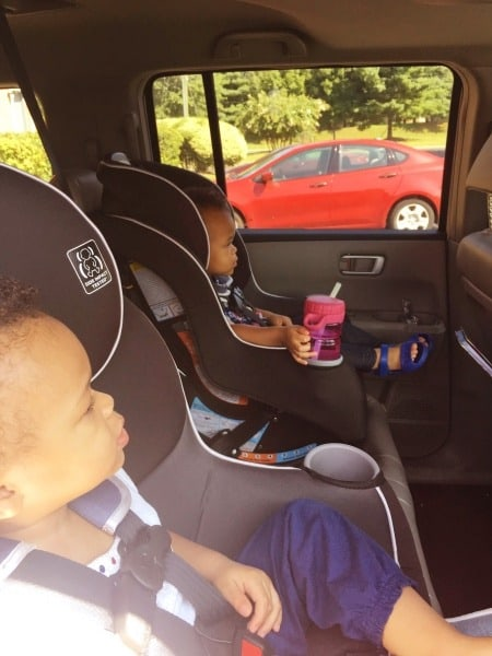 twin toddlers in car seats road trips with twins