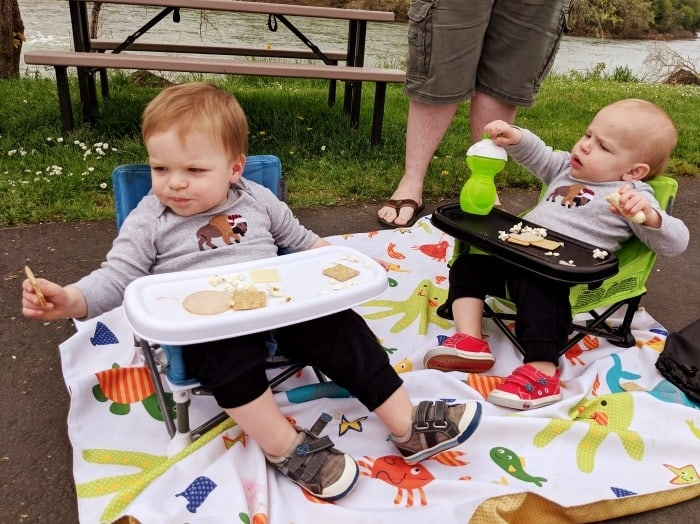 toddler twins eating lunch at rest stop road trips with twins