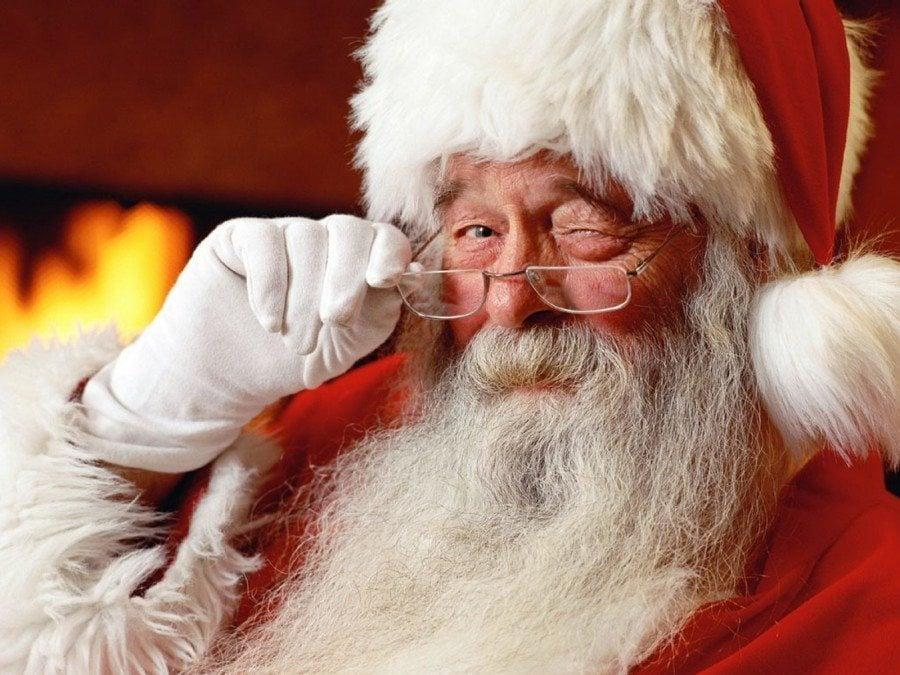 santa claus winking and wearing glasses newborn twins