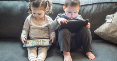 two kids playing tablets Apps for Ages 2-6