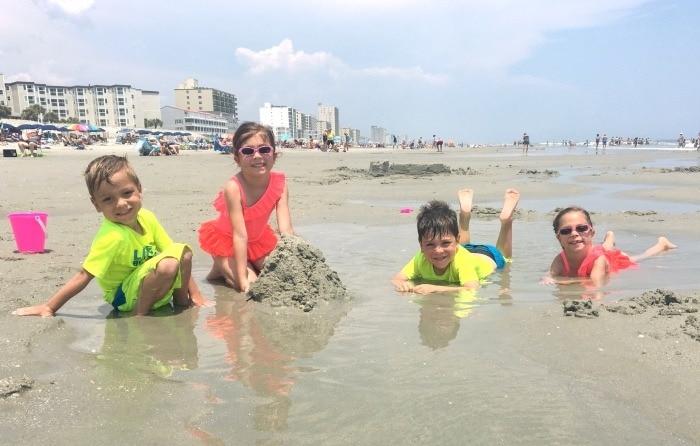 kids at the beach summer shopping