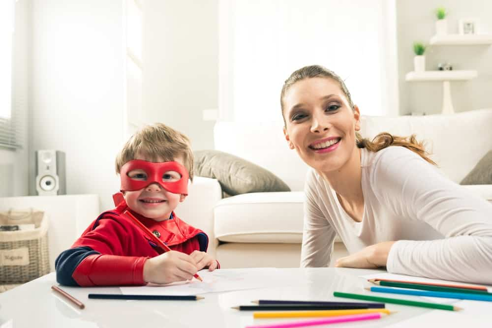mom and child in a mask and cape