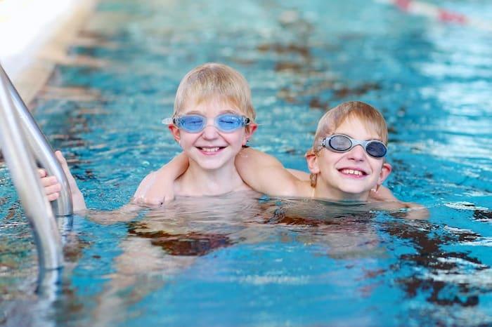 junior high school twin boys in swimming pool