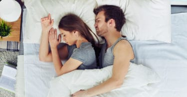 husband and wife sleeping in a bed sex drive after twins