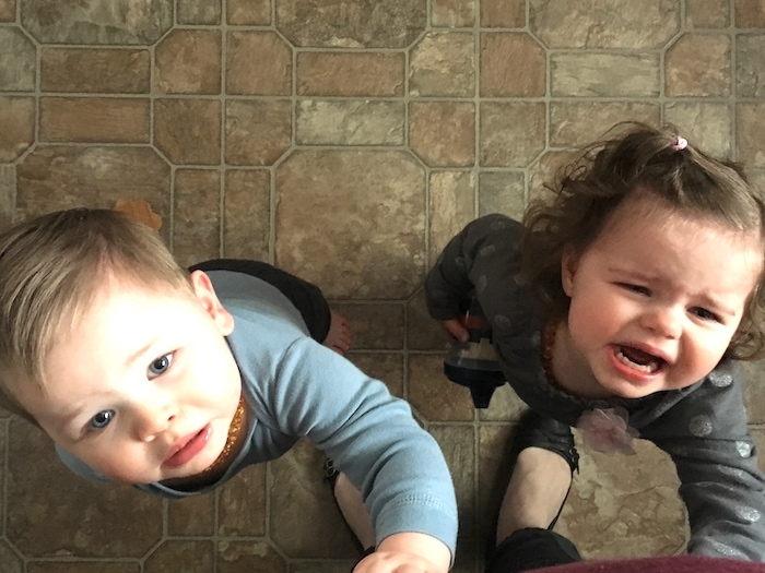 twin toddlers crying and looking up cold and flu season