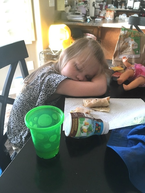 little girl fell asleep at the table cold and flu season