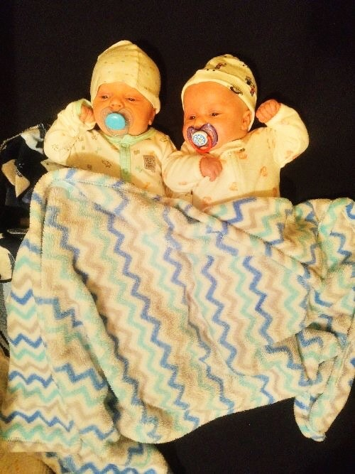 newborn twins laying on the floor sleep regressions