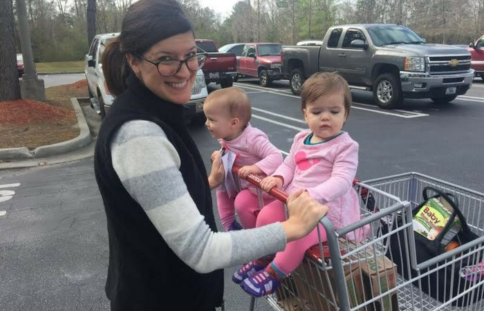 Mom pushing twins in cart