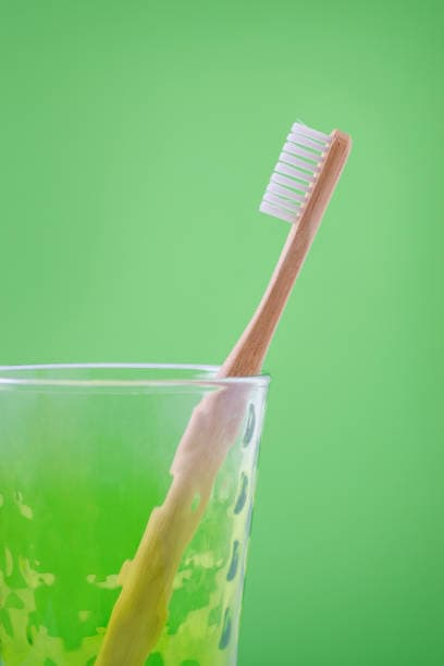 toothbrush in a glass oral care routine