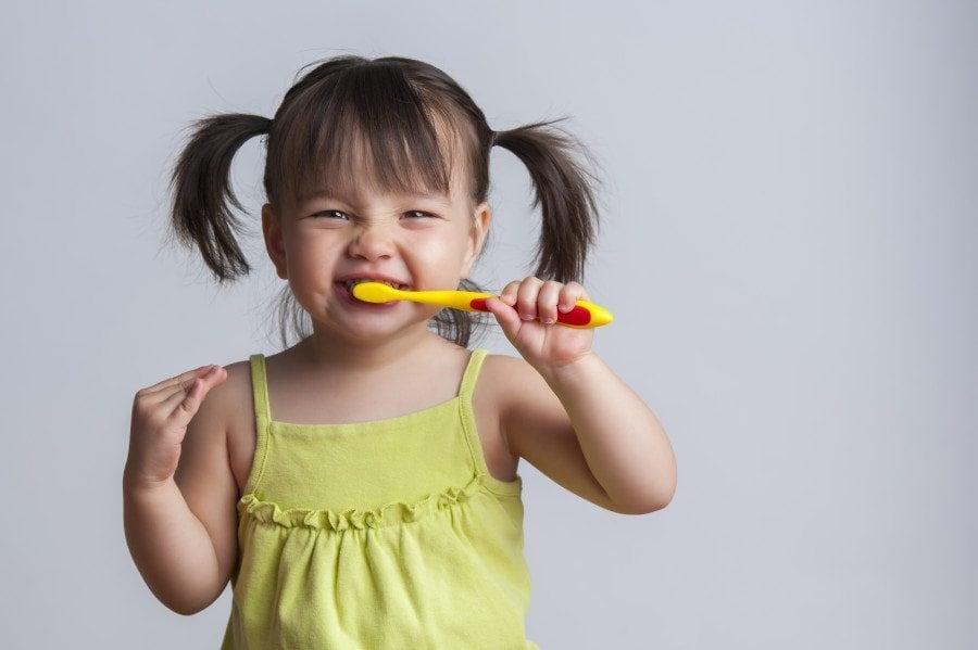 girl brushing teeth oral care routine