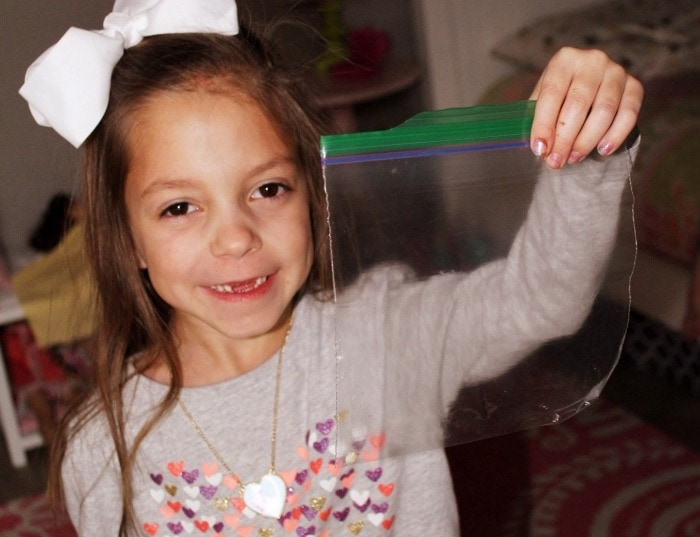 girl holding lost tooth fairy