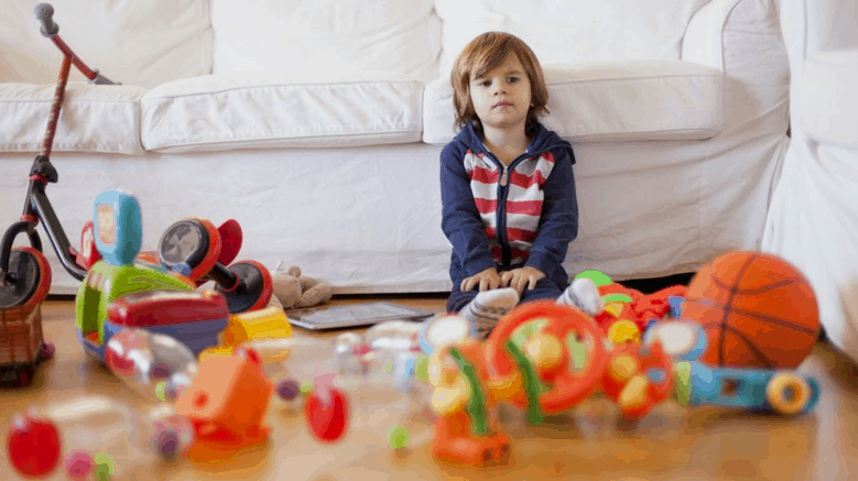 boy sitting on floor with toys kids toys