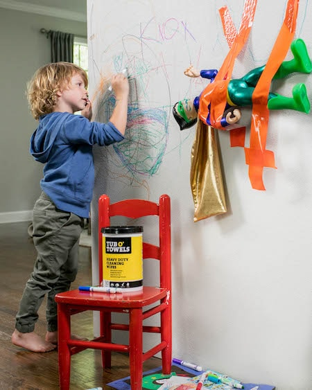 boy drawing on wall after school messes