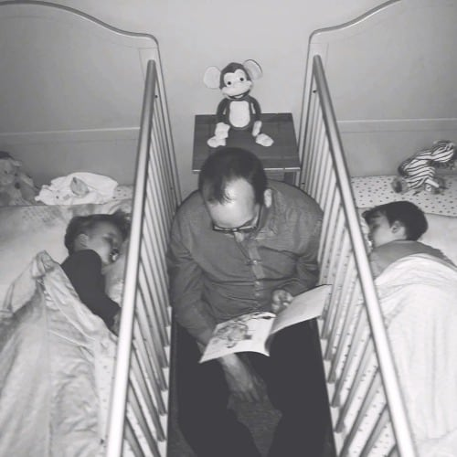 dad reading between cribs twin dads