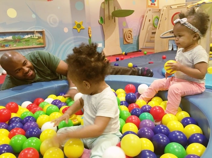 dad with twin girls in ball pit twin dads