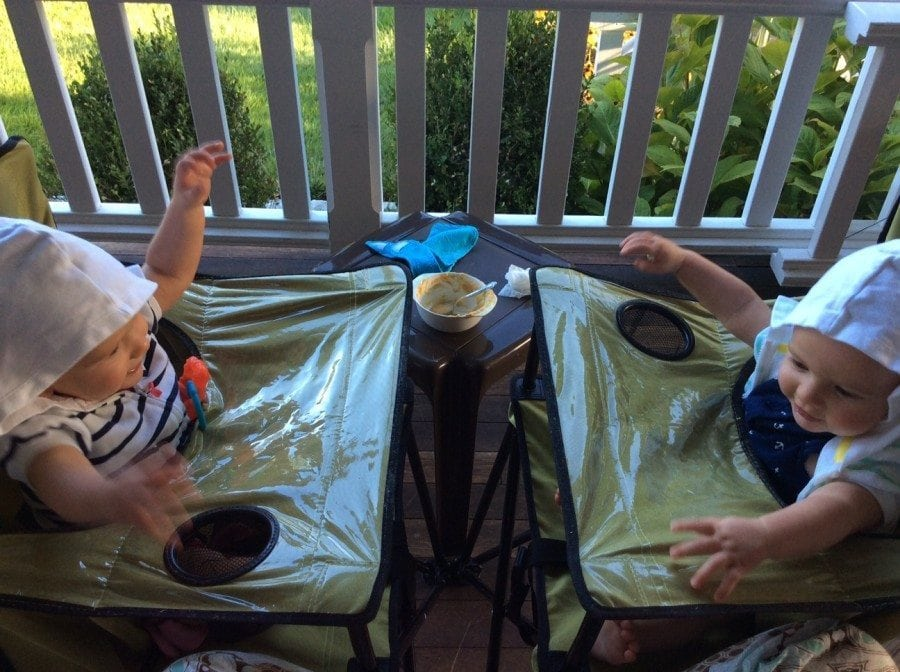9 Hacks to Make Twin Life Easier twins sitting in high chairs