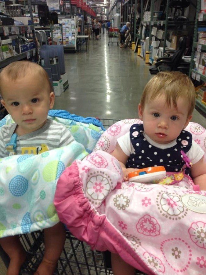 twins in a shopping cart twin milestones