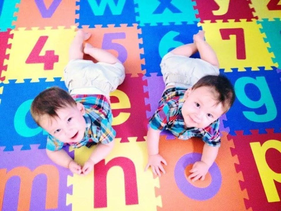 twins on play mat stay home or work