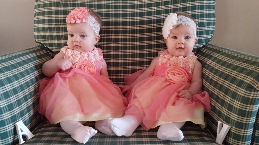 infant twins on a chair twin milestones
