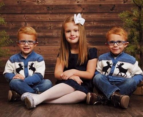 three kids sitting on floor w-sitting