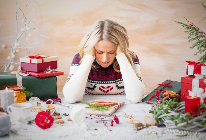 woman stressed about christmas holiday stress